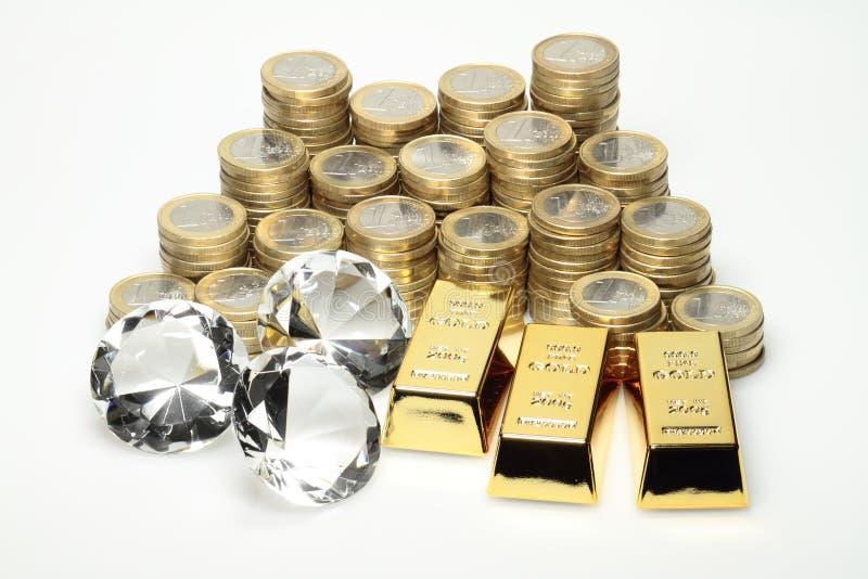 Oro, diamantes, monedas euro foto de archivo libre de regalías