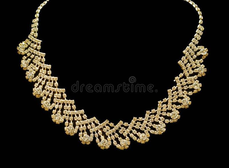 Oro e collane di diamante isolate su fondo nero fotografia stock libera da diritti