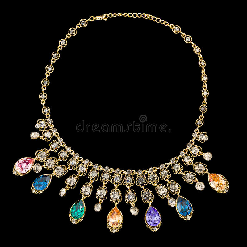 Oro e collane di diamante isolate su fondo nero immagini stock libere da diritti