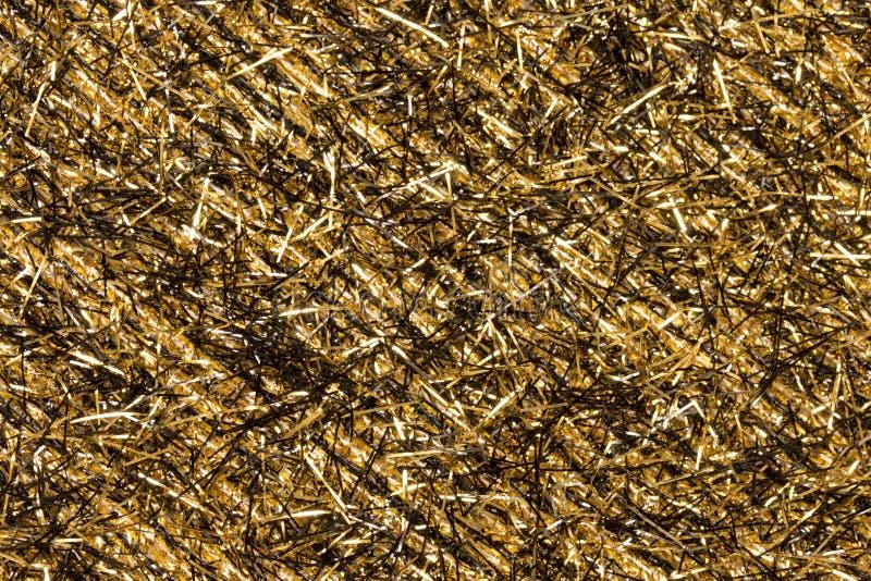 Oro e fondo nero di Natale del lamé fotografia stock