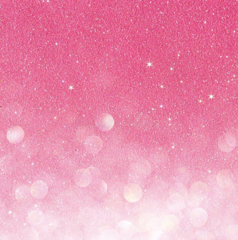 Oro e luci astratte del bokeh di rosa Priorità bassa Defocused fotografie stock libere da diritti