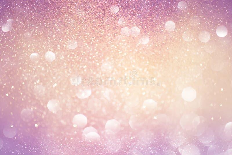 Oro e luci astratte del bokeh di rosa Priorità bassa Defocused immagine stock
