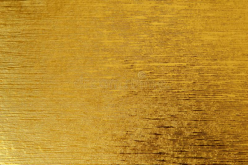 Oro giallo della foglia sventare fondo strutturato adatto a qualsiasi progettazione immagine stock libera da diritti