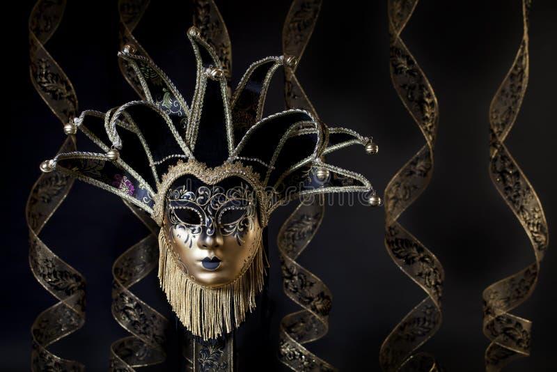 Oro nero Jester Mask veneziano immagini stock libere da diritti