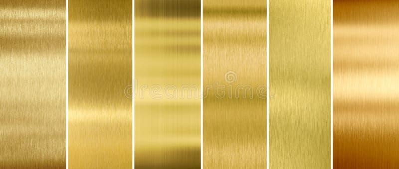 Oro o texturas cepilladas latón del metal fijadas foto de archivo