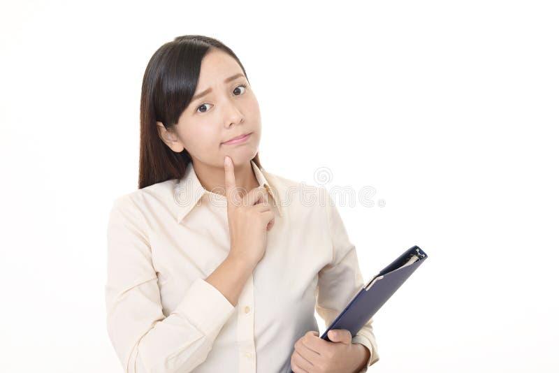 Orolig asiatisk kvinna arkivbilder