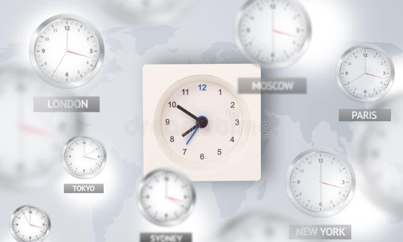 Orologi e fasce orarie sopra il concetto del mondo immagini stock