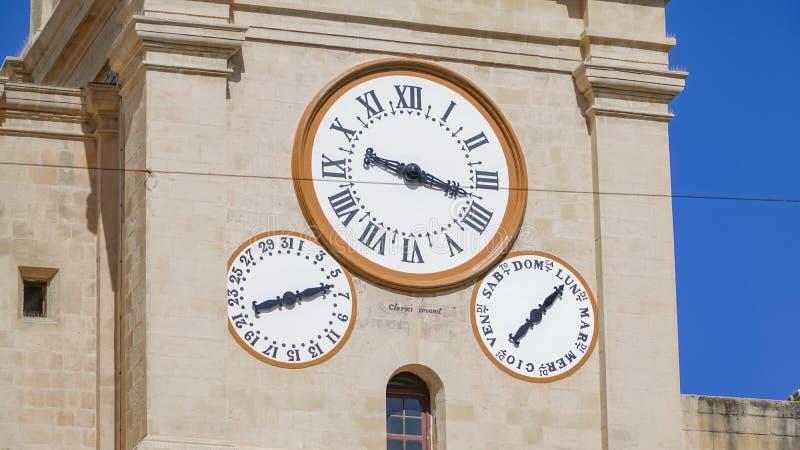 Orologio antico nella città antica di La Valletta, Malta immagini stock