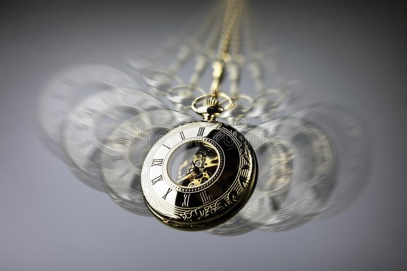 Orologio da tasca di ipnosi immagine stock libera da diritti