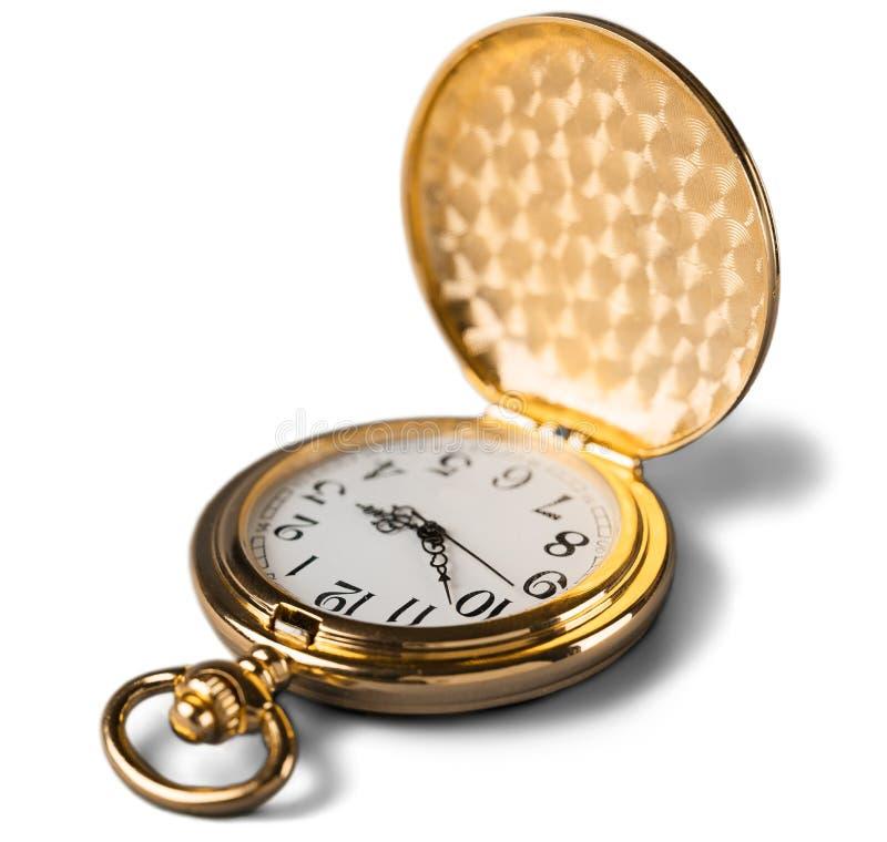 Orologio da tasca dorato d'annata immagini stock