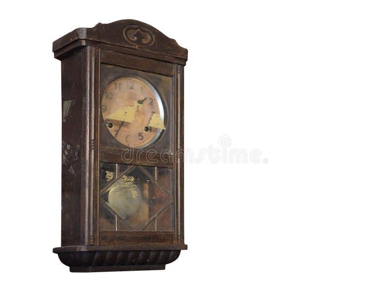 Orologio di parete di legno marrone antico laterale su fondo bianco, fondo dell'oggetto, tecnologia, spazio della copia fotografie stock libere da diritti