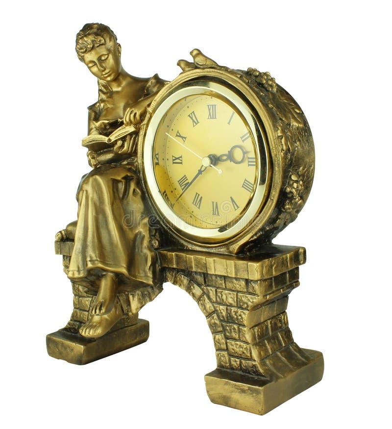 Orologio di tavola d'annata con una statua di una ragazza che legge un libro fotografia stock libera da diritti