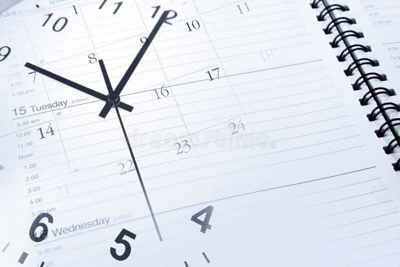 Orologio e diario immagine stock