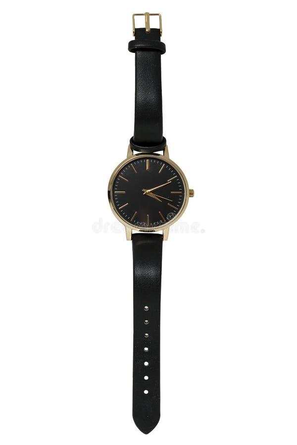 Orologio femminile nel caso dell'oro ed in cinghia di cuoio nera fotografia stock