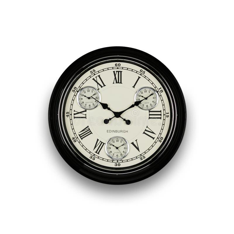 Orologio nero su una parete bianca a 10 - 2 immagini stock