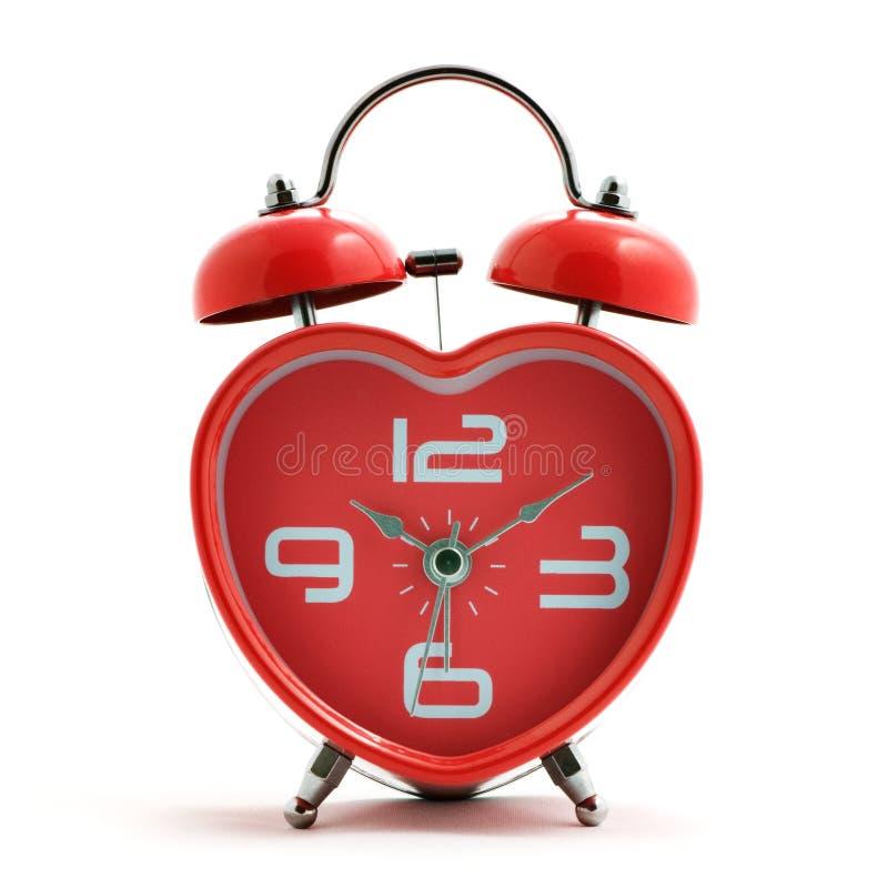 Orologio rosso del cuore immagine stock