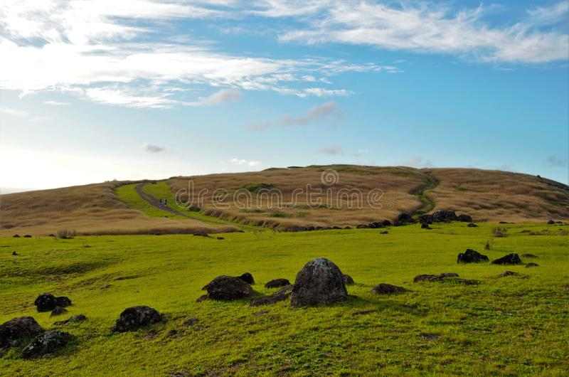 Orongo Village. Long shot of the Orongo village between the Rano Kau crater and the Pacific ocean close to Hanga Roa the capital of Easter Island, Rapa Nui royalty free stock photo