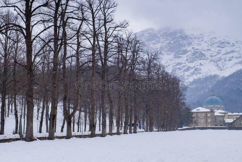 Oropa Sanctuary, Piedmont - Italy. Oropa Sanctuary during winter with snow, Biella province, Piedmont, Italy, Unesco heritage stock photo