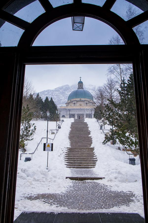 Oropa Sanctuary, Piedmont - Italy. Oropa Sanctuary during winter with snow, Biella province, Piedmont, Italy, Unesco heritage stock photography