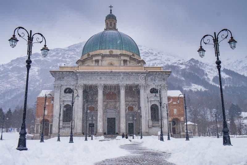 Oropa Sanctuary, Piedmont - Italy. Oropa Sanctuary during winter with snow, Biella province, Piedmont, Italy, Unesco heritage stock photos
