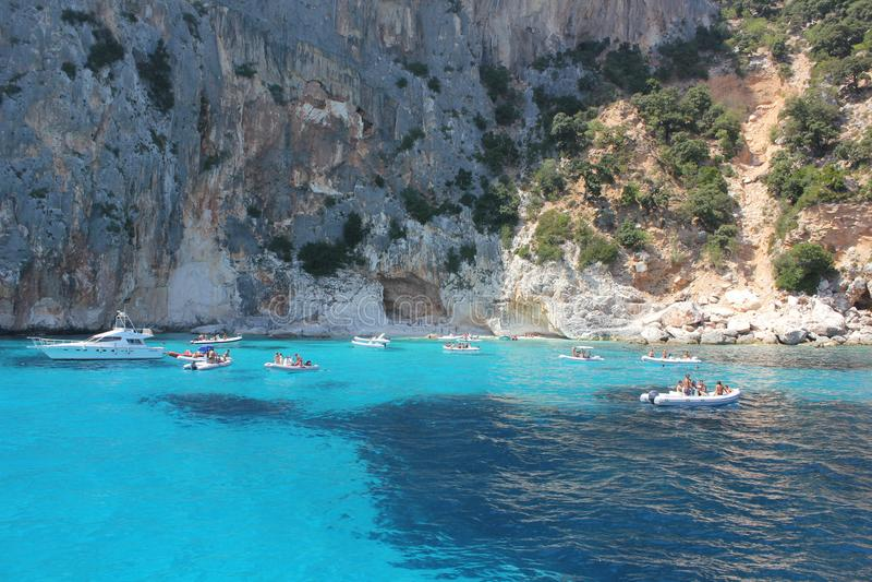 OROSEI AUG 2011 - ITA Turquoise sea in the beautiful bay in the Gulf of Orosei, Sardinia - Italy royalty free stock photos