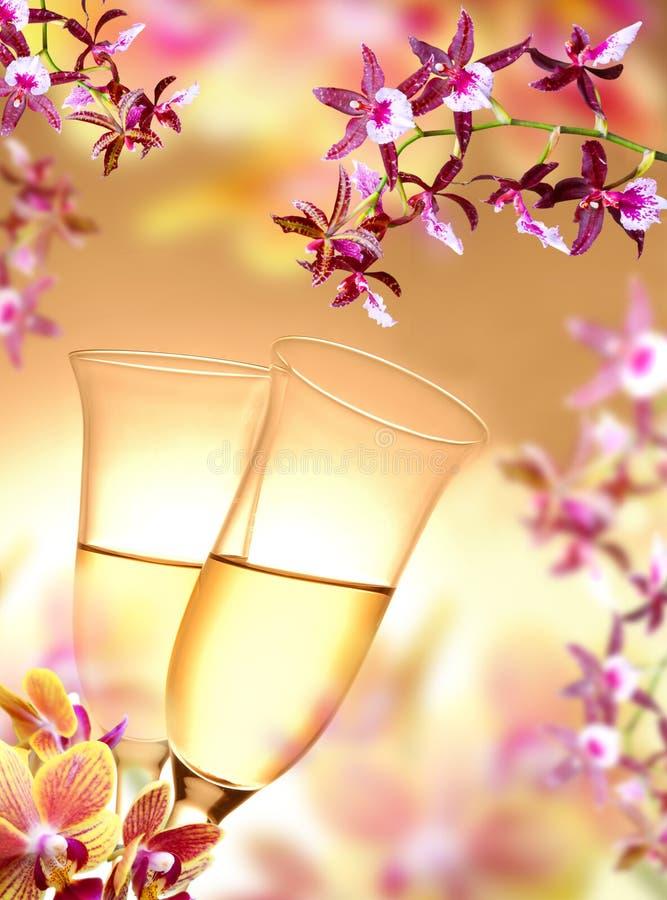 Orquídea y champán imagen de archivo libre de regalías