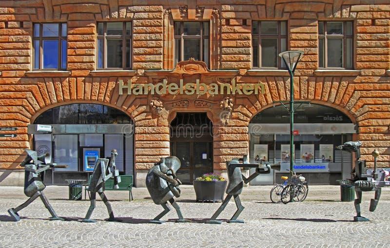 A orquestra dos otimista é escultura na rua de Sodergatan em Malmo, Suécia imagem de stock