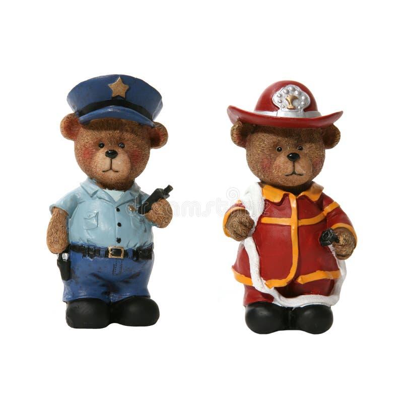 Orsi del vigile del fuoco e del poliziotto fotografia stock libera da diritti