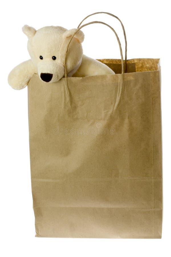 Orso dell'orsacchiotto in sacco di carta marrone immagine stock