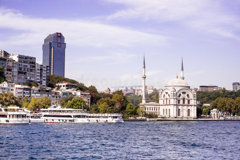 Ortakoy Mosque from Bosphorus in Istanbul, Turkey. Situated at the waterside of the Ortakoy pier square, one of the most popular l stock photo