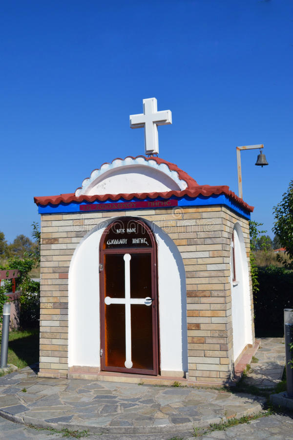 Orthodox chapel in Greece. Small Orthodox chapel in Greece, for those who do not have time to go to church, chapel or they may incidentally to light candles for stock photo