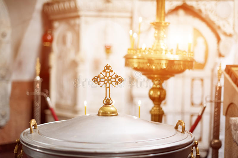 Orthodox christian church interior. Cross and candles during worship. Orthodox christian church interior. Cross and candles during worship royalty free stock photo