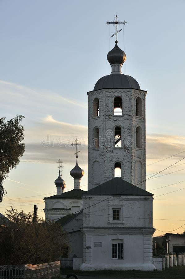 Orthodox Christian white stone Church in Russia on the banks of the Volga river on a summer day in the evening.  royalty free stock photos