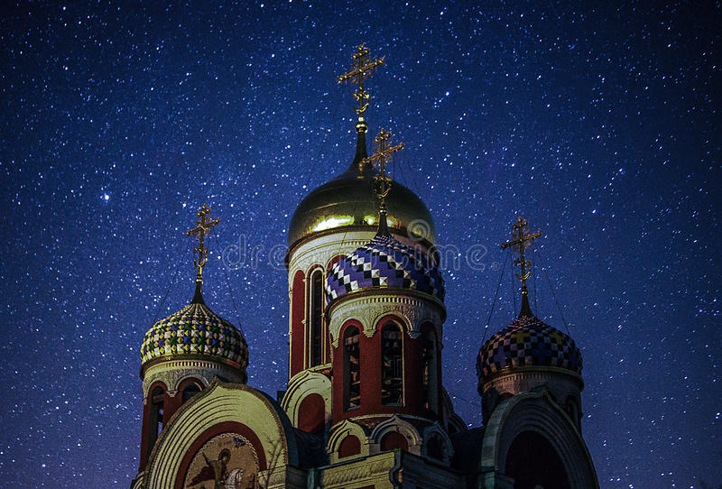 Orthodox Church against the starry sky. The architecture of Orthodox churches and monasteries characterized by beauty and national identity. The gilded domes royalty free stock photos