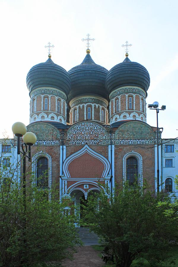 Orthodox Church with black domes in Izmailovsky Park of Moscow Russia on the background of green spring trees stock photo