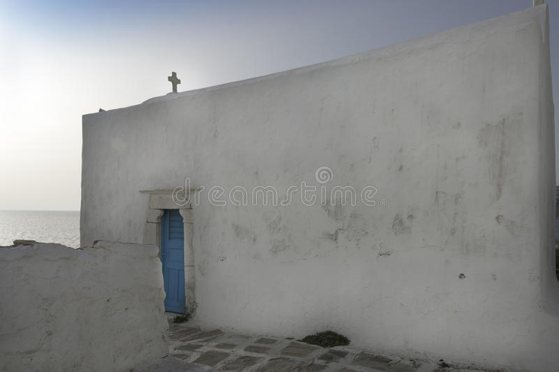 Orthodox church with blue door. Old Orthodox church with blue door on the Aegean sea, Mykonos, Greece royalty free stock photography