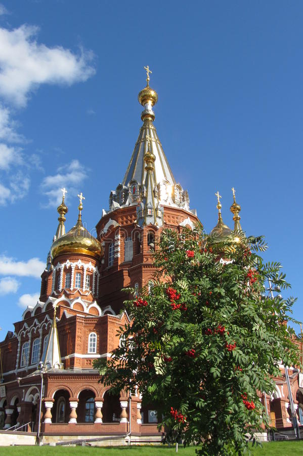 Orthodox church in the city of Izhevsk, Russia. St. Michael's Cathedral in Izhevsk, Russia, Mountain ash berries in autumn royalty free stock photos