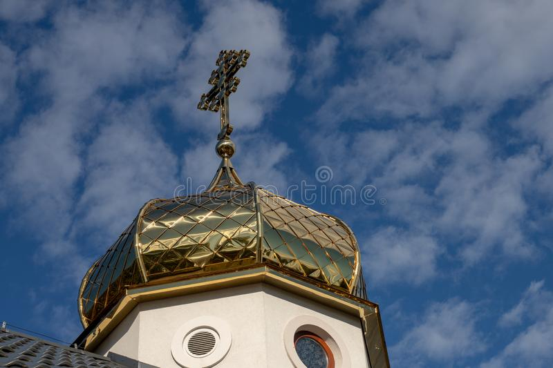 Orthodox church with a gilded tower. Church in Central Europe. stock photo