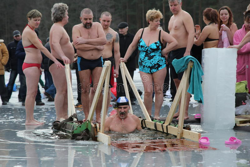 Orthodox church Holy Epiphany Day. Weather -15. DAUGAVPILS, LATVIA - January 19, 2015: Orthodox church Holy Epiphany Day. Weather -15. People bathed in the ice stock photos