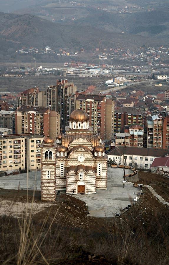 Orthodox church in Kosovo. Orthodox Church and panorama of Kosovska Mitovica, Kosovo royalty free stock photos