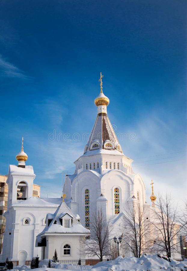 Orthodox church in the morning in the winter with snow on the roof, Russia, Togliatti. Orthodox church in the morning in the winter with snow on the roof, Russia stock images