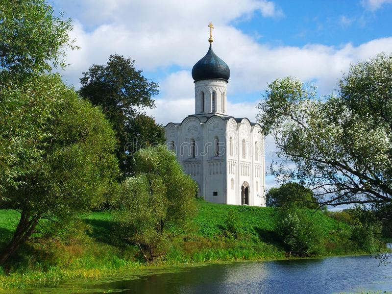 Orthodox church on a riverbank stock photos