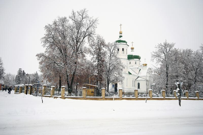 Orthodox church on a snowy background. Symbolizing faith and love and hope, uniting people into one group of Christians stock image