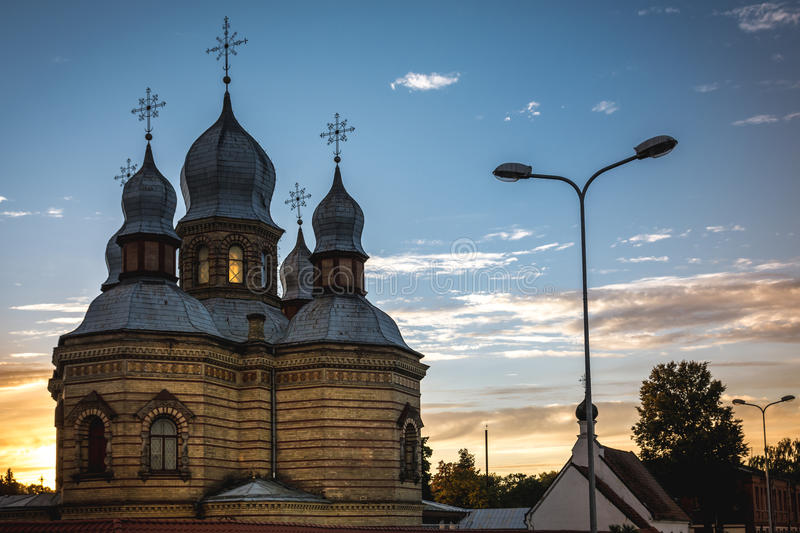 Orthodox church at sunset in the city landscape stock image