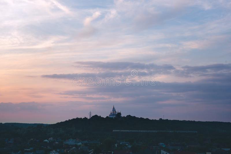 Orthodox church sunset magenta sky poltava ukraine. Travel religious concept stock image