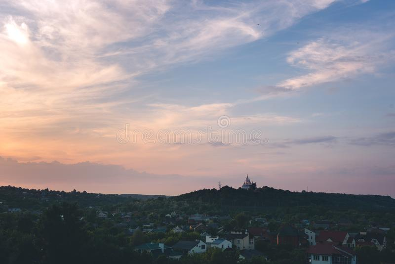 Orthodox church sunset magenta sky poltava ukraine. Travel religious concept stock photo