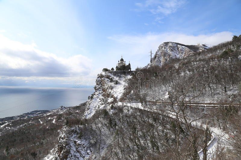 Orthodox church on top of the mountain and the road. royalty free stock photography