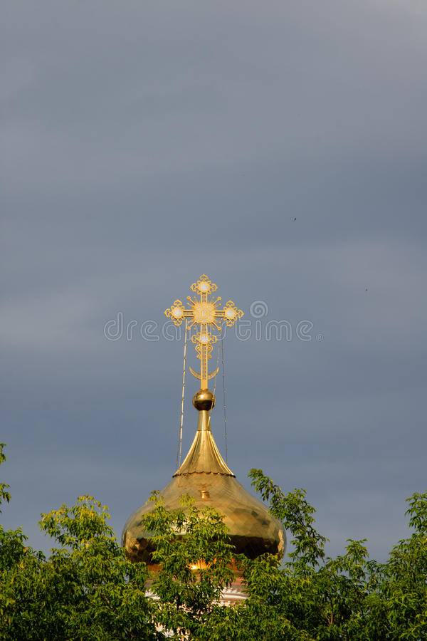 Orthodox cross on a gold dome. royalty free stock photography