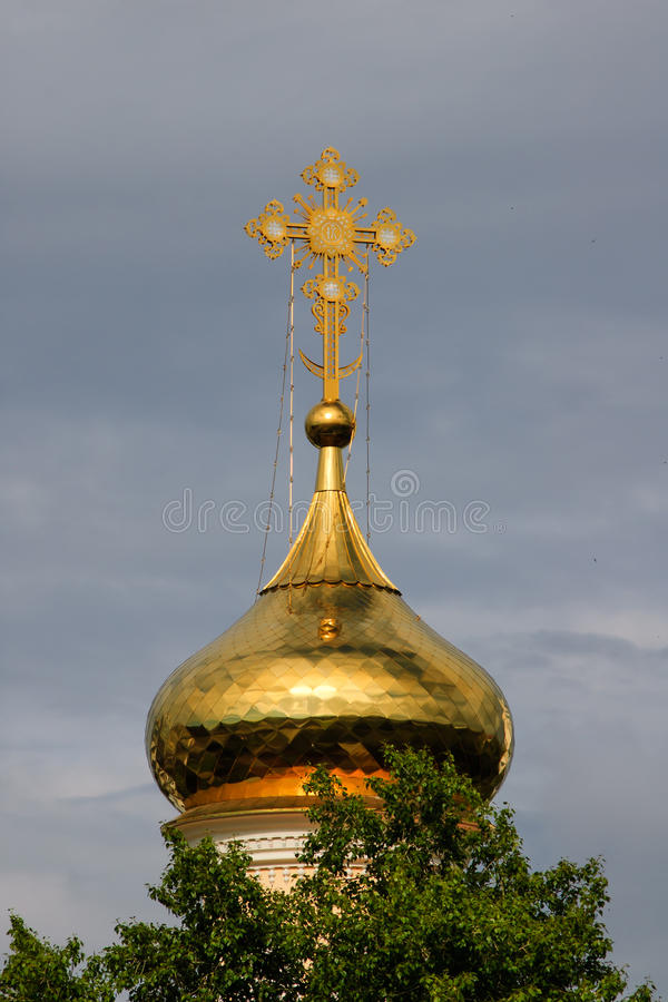 Orthodox cross on a gold dome. stock photos