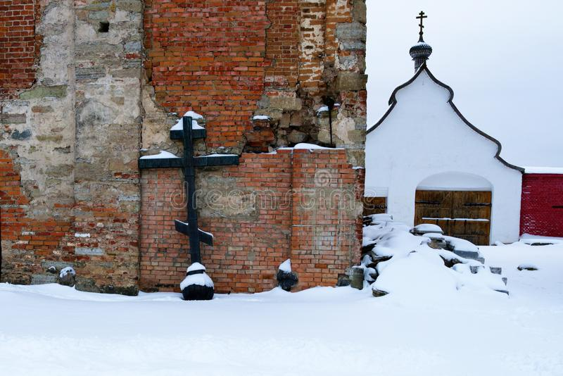 Orthodox cross, shot from the dome of the dilapidated chapel in the men`s monastery, Russia, winter. stock images